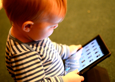 Toddler with an iPad